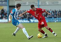 Photo: Ashley Pickering.<br />Norwich City v Cardiff City. Coca Cola Championship. 21/10/2006.<br />Cardiff's Joe Ledley takes on the Colchester defence