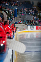 KELOWNA, CANADA - FEBRUARY 17: Helmets and sticks line the boards on the bench on February 17, 2017 at Prospera Place in Kelowna, British Columbia, Canada.  (Photo by Marissa Baecker/Shoot the Breeze)  *** Local Caption ***