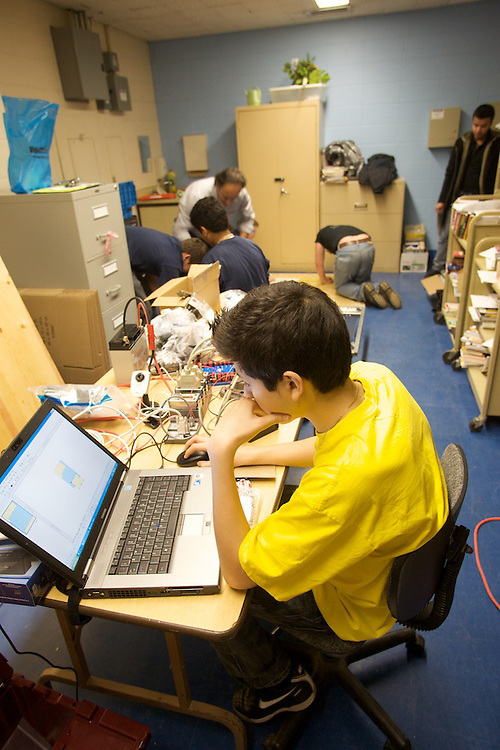 Ecole Pierre Dupuy students prepare for the 2010 FIRST Robotics competition. Their participation in the competition is thanks to the aid and planning of Fusion Jeunesse interns and staff.