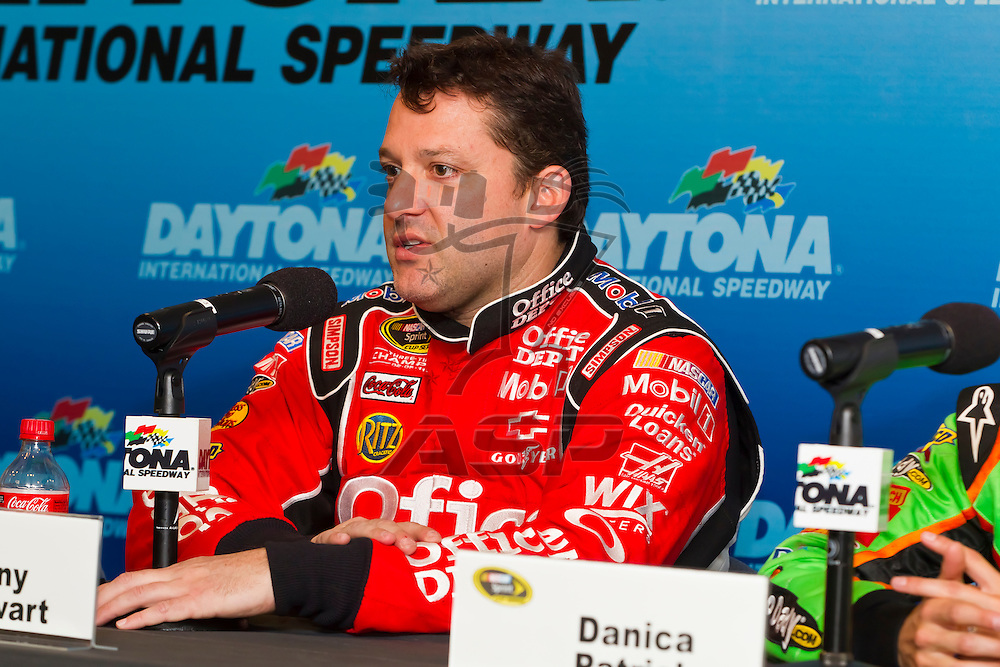 12 January, 2012:   Tony Stewart (14) and Danica Patrick (10) take questions from the media during open testing for the NASCAR Sprint Cup Series at the Daytona International Speedway in Daytona Beach, FL.