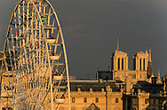 France. Paris. 1st district. Elevated view.  Paris, ferris wheel , The pyramide of the louvre museum and Notre dame cathedral,  view from  the hotel Meurice. / Architecte, PEY. to use the picture you have to contact the EPGL etablissement public du grand Louvre.