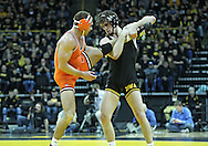 January 07, 2011: Iowa's Mike Evans grabs the leg of Oklahoma State's Dallas Bailey during the 165-pound bout in the NCAA wrestling dual between the Oklahoma State Cowboys and the Iowa Hawkeyes at Carver-Hawkeye Arena in Iowa City, Iowa on Saturday, January 7, 2012. Evans won 5-1.