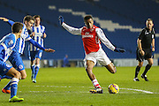 Arsenal's Alex Iwobi shoots during the Barclays U21 Premier League match between Brighton U21 and Arsenal U21 at the American Express Community Stadium, Brighton and Hove, England on 1 December 2014.
