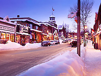Snowy winter scenery of a Canadian town Huntsville before Christmas, shops on Main street, town center, Muskoka, Ontario, Canada 2016 snowy winter scenery. The Nutty Chocolatier, Town hall and other buildings.