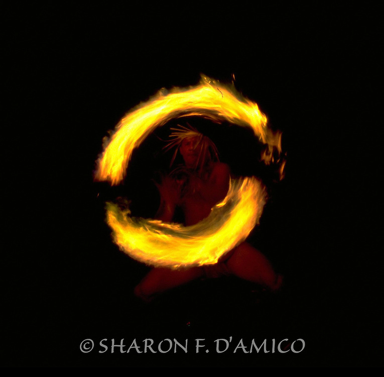 A Highly Skilled Hawaiian Fireknife Dancer Demonstrates Ceremonial Fire Spinning.