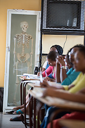 2 March 2017, Ma Mafefooane Valley, Lesotho: Anatomy class, as part of a course in Anatomy and physiology for first-year students in the general nursing programme. This lesson is on the neural system. The class consists of 31 students, both men and women, and is in its second semester. The Roma College of Nursing is a Roman Catholic non-profic institution under the Christian Health Association of Lesotho. The college educates nurses and midwives, and is situated adjacent to Saint Joseph's Hospital in the Ha Mafefooane Valley, some 35 kilometers from Lesotho's capital, Maseru. The school forms an integral part of Saint Joseph's Hospital, where the students acquire essential parts of their hands-on training. The school was founded in 1972, and is open to candidates of any gender and various religious backgrounds. Applications are also open to students from other countries. Most students begin their studies at the age of 19-20. Most are from Lesotho, but some are international. The college hosts a total of some 120 students. Four out of five are women. Through sponsorship from ICAP and the Nursing Education Partnership Initiative (NEPI), which draws funds from PEPFAR, the school maintains a library and a skills laboratory specifically designed to improve nursing education in Lesotho. There are six nursing training institutions in Lesotho in total, of which four are denominational as part of the Christian Health Association of Lesotho, and thus owned by the churches. Two institutions are public, run by the government.