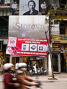 31 MARCH 2012 - HANOI, VIETNAM:   A portrait of the late Steve Jobs above a store selling Apple products, like the iPhone, iPad and Macintosh computers in the Old Quarter of Hanoi, Vietnam. Vietnam is ostensibly a socialist country but the recent economic boom has seen large numbers of foreign owned businesses catering to wealthy Vietnamese and foreign tourists opening in the larger cities.   PHOTO BY JACK KURTZ