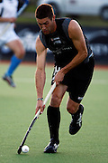 Joel Baker in action, Black Sticks Men v Junior Black Sticks, Build up match to the BDO World Cup Qualifying Hockey Tournament. Crown Relocations Hockey Stadium, North Harbour, Auckland, New Zealand. 29 October 2009. Photo: William Booth/PHOTOSPORT