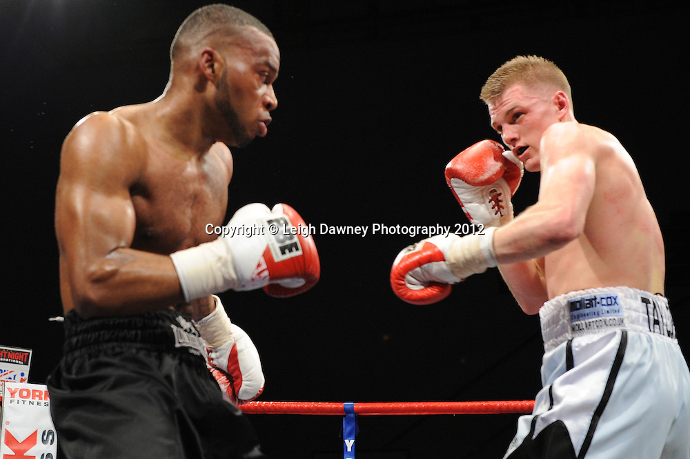 Lewis Taylor (white shorts) defeats Gilson De Jesus in a Middleweight contest on 3rd March 2012 at the Hillsborough Leisure Centre. Frank Maloney & Dennis Hobson Promotions © Leigh Dawney Photography 2012.