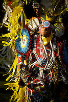 JEROME A. POLLOS/Press..The setting sun highlights the vibrant colors of a dancer's regalia during the grand entrance.