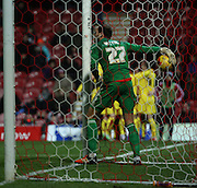 \b27/ picking ball out of the nte after Burnley scored theie third goal during the Sky Bet Championship match between Brentford and Burnley at Griffin Park, London, England on 15 January 2016. Photo by Matthew Redman.