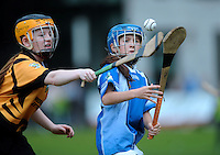 20 Aug 2016: Jen O'Donoghue, left, Kilkenny, in action against Alisha Quinn, Galway.  Camogie U14.  2016 Community Games National Festival.  Athlone Institute of Technology, Athlone, Co. Westmeath. Picture: Caroline Quinn