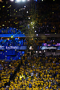 Confetti falls as the Golden State Warriors celebrate beating the Cleveland Cavaliers during Game 5 of the NBA Finals to become NBA Champions at Oracle Arena in Oakland, Calif., on June 12, 2017. (Stan Olszewski/Special to S.F. Examiner)