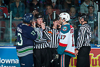 KELOWNA, CANADA - APRIL 25: Rodney Southam #17 of the Kelowna Rockets and Mathew Barzal #13 of the Seattle Thunderbirds stand at the penalty box with referees Brett Iverson and Fraser Lawrence as a goal is under review with the goal judges on April 25, 2017 at Prospera Place in Kelowna, British Columbia, Canada.  (Photo by Marissa Baecker/Shoot the Breeze)  *** Local Caption ***