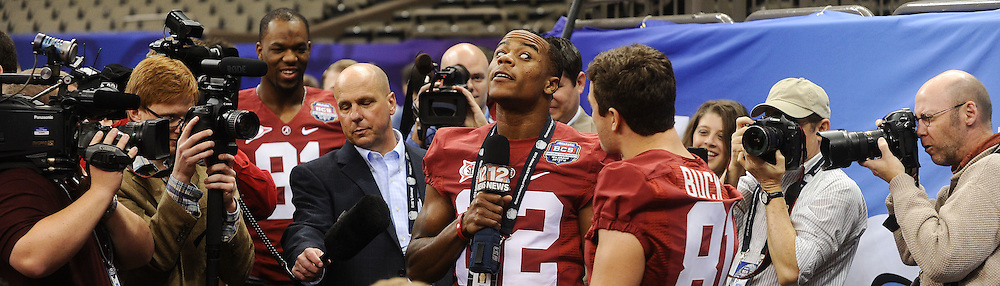 "Daily Photo by Gary Cosby Jr.    ..Alabama football players meet the media inside the Superdome in New Orleans for media day Friday, January 6.  Reserve wide receiver Christion Jones makes the most of his media day as he poses as a reporter and ""interviews"" teammate Hardie Buck..................................."