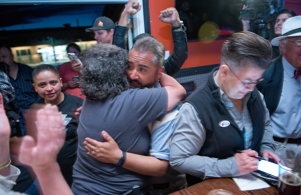 em050217j/a/City Councilor Ron Trujillo celebrates with others as the results of the soda tax election come in. They were at a party by Smart Progress New Mexico at the Boxcar in Santa Fe, Tuesday May 2, 2017. Trujillo opposed the tax. (Eddie Moore/Albuquerque Journal