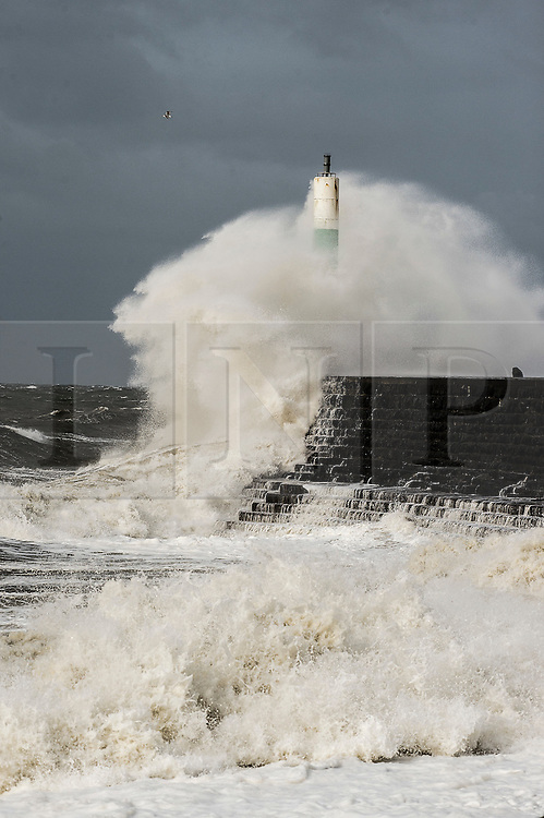 © London News Pictures. 02/03/2016. Aberystwyth, UK. <br /> At the peak of the tide monstrous waves crash over the harbour wall and lighthouse as gale force winds again hit Aberystwyth in West Wales .  Gusts of up to 70mph are predicted  to affect western coastal areas, , making for difficult driving conditions and bringing the risk of some structural damage . Photo credit: Keith Morris/LNP