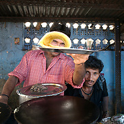 A man serves Dosa at a south Indian food stall. Dosa is the Indian equivalent of the French Crepe. Mumbai, June 2007