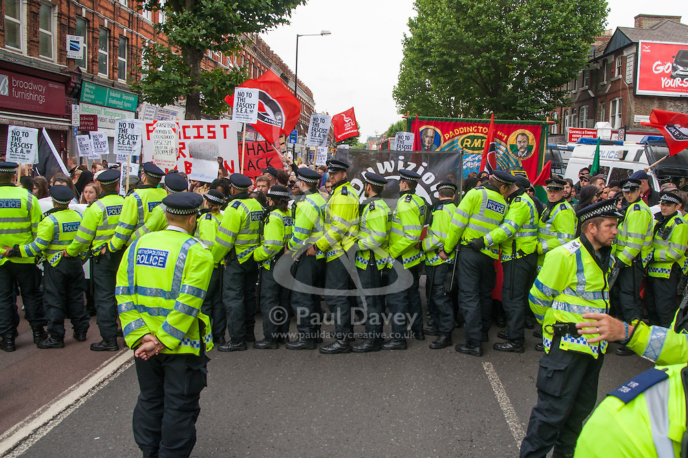 "Cricklewood, London, July 19th 2014. Large numbers of police were required to keep scores of anti-fascist counter-protesters separate from 13 ""South East Alliance""  far right anti-Islamists, demonstrating near the London offices of Egypt's Muslim Brotherhood,"