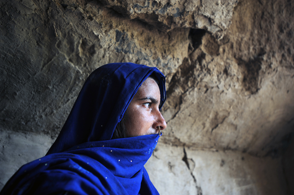 1/8/2009 Bakhat Nazeera from Swat  looks outside the cave in Haripur where she is living with her family until it is safe to return home. 1.7 million people were displaced since April following heavy fighting between the Taliban and Government forces in Northern Pakistan. PHOTO KIM HAUGHTON