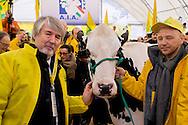 Roma 6 Febbraio 2015<br /> Manifestazione in Campidoglio, per &laquo;difendere il latte italiano&raquo;, organizzato dalla Coldiretti, e l&rsquo;Associazione italiana allevatori che  hanno portato le  mucche  nelle piazze italiane per sensibilizzare opinione pubblica e istituzioni sulla crisi del settore lattiero-caseario. Il ministro del Lavoro Giuliano Poletti con la mucca della Coldiretti<br /> Rome February 6, 2015<br /> Demostration  at the Capitol, to &quot;defend the Italian milk&quot;, organized by Coldiretti, and the Association of Italian farmers who brought the cows in the Italian squares to sensitize public opinion and institutions on the crisis of the dairy sector.  The  Minister Labour  Giuliano Poletti, with the cow of the Coldiretti.