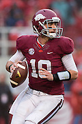 FAYETTEVILLE, AR - OCTOBER 11:  Brandon Allen #10 of the Arkansas Razorbacks drops back to pass against the Alabama Crimson Tide at Razorback Stadium on October 11, 2014 in Fayetteville, Arkansas.  The Crimson Tide defeated the Razorbacks 14-13.  (Photo by Wesley Hitt/Getty Images) *** Local Caption *** Brandon Allen