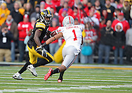 November 20 2010: Iowa Hawkeyes wide receiver Marvin McNutt (7) tries to get around Ohio State Buckeyes defensive back Devon Torrence (1) during the first quarter of the NCAA football game between the Ohio State Buckeyes and the Iowa Hawkeyes at Kinnick Stadium in Iowa City, Iowa on Saturday November 20, 2010. Ohio State defeated Iowa 20-17.