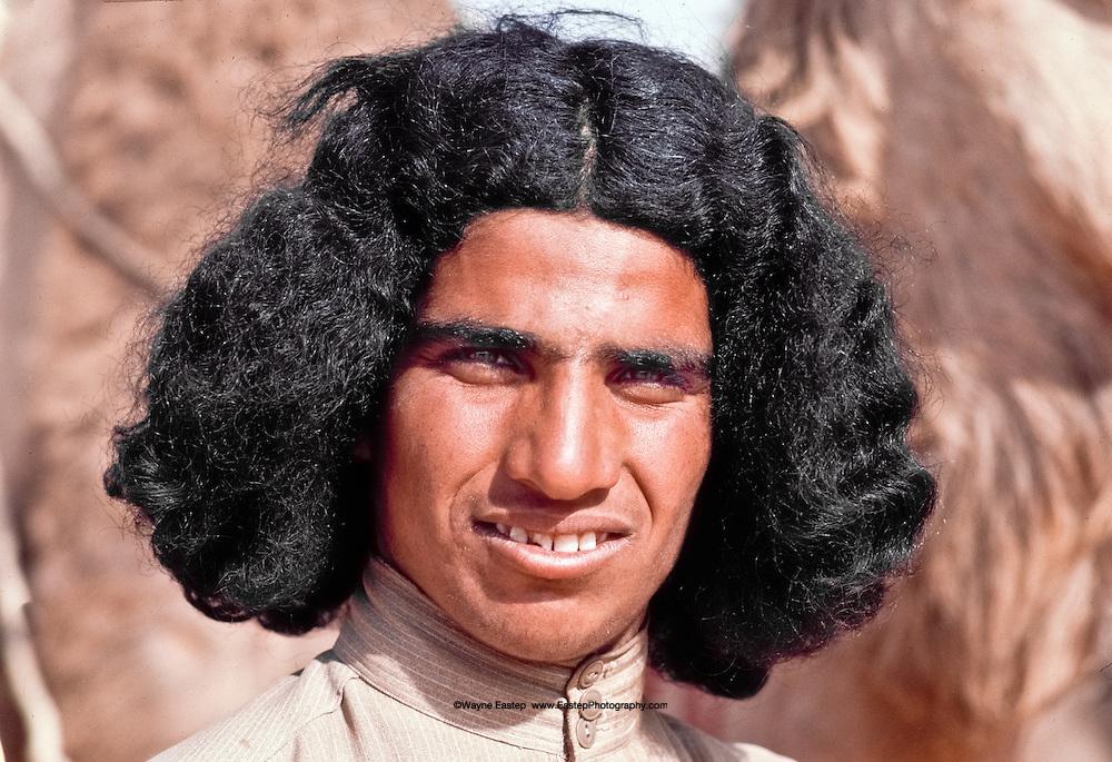 Young man competing in the annual camel race at Jinayderiah, near Riyadh, Saudi Arabia