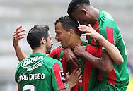 Fransergio, jogador da equipa do Maritimo (C) , festeja o golo com os seus companheiros de equipa durante o jogo da primeira liga portuguesa de futebol Maritimo vs Vitória de Guimarães realizado no Estádio dos Barreiros, Funchal, 17 de Abril de 2016.<br /> GREGÓRIO CUNHA/LUSA