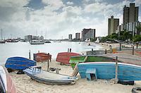 Traditional flat bottom boats along the beach of Fortaleza.