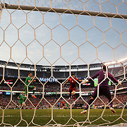 Hugo Almeida, Portugal, scores the first of his two goals beating Ireland keeper David Forde during the Portugal V Ireland International Friendly match in preparation for the 2014 FIFA World Cup in Brazil. MetLife Stadium, Rutherford, New Jersey, USA. 10th June 2014. Photo Tim Clayton