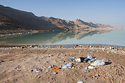 Dirty Beach. Rubbish left by visiters on the shore of the Dead Sea, Israel