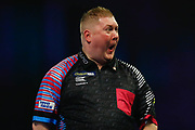 Ricky Evans celebrates winning a leg and pulls a funny face during the Darts World Championship 2018 at Alexandra Palace, London, United Kingdom on 18 December 2018.