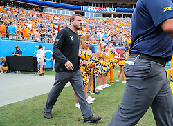 Sep 1, 2018; Charlotte, NC, USA; West Virginia Mountaineers offensive coordinator Jake Spavital walks onto the field pregame before their game against the Tennessee Volunteers at Bank of America Stadium. Mandatory Credit: Ben Queen-USA TODAY Sports