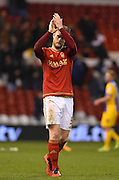 Nottingham Forest defender Matt Mills (Capt) applauses the Forest fans after winning 1 - 0 during the Sky Bet Championship match between Nottingham Forest and Preston North End at the City Ground, Nottingham, England on 8 March 2016. Photo by Jon Hobley.