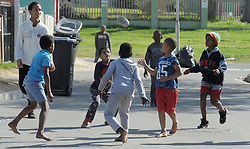 South Africa - Cape Town - 28 June 2020 - Children playing outside as South Africa's public schools has closed again for a month from Monday to limit the spread of the novel coronavirus as the country grapples with surging infections, President Cyril Ramaphosa has said. The country has now recorded over 400,000 coronavirus cases, the fifth-highest in the world, and more than 6,000 people have died from the virus. Rising infections have caused concern among teaching staff, with unions calling on the government to revoke its decision to reopen schools for certain grades in June. Picture: Brendan Magaar/African News Agency(ANA)