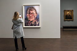 "© Licensed to London News Pictures. 11/04/2019. LONDON, UK. A visitor views ""Untitled"", 2019, by Jenny Saville, a new work, seen for the first time, created in response to Rembrandt's self-portrait, ""Self-Portrait with Two Circles"" (R) which is the highlight of the exhibition.  Preview of ""Visions of the Self:  Rembrandt and Now"", an exhibition at Gagosian Grosvenor Hill, in partnership with English Heritage.  The show features self-portraits by Pablo Picasso, Frances Bacon, Lucian Freud and Jean-Michel Basquiat alongside contemporary artists including George Baselitz, and Damian Hirst.  Photo credit: Stephen Chung/LNP"