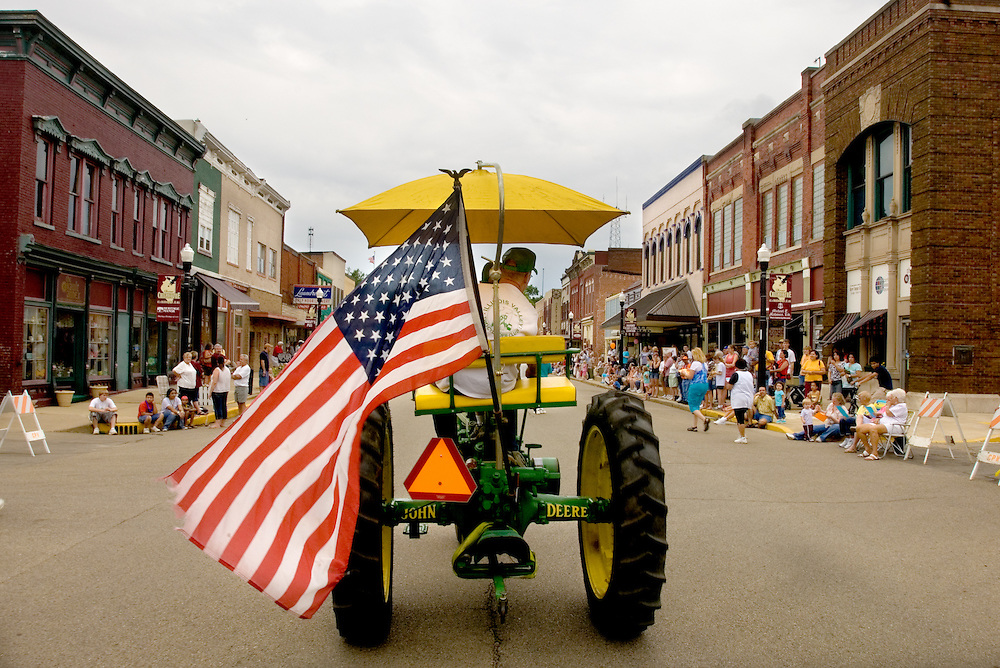 A tractor makes its way along the parade route during a summer festival in Chillicothe, Illinois.