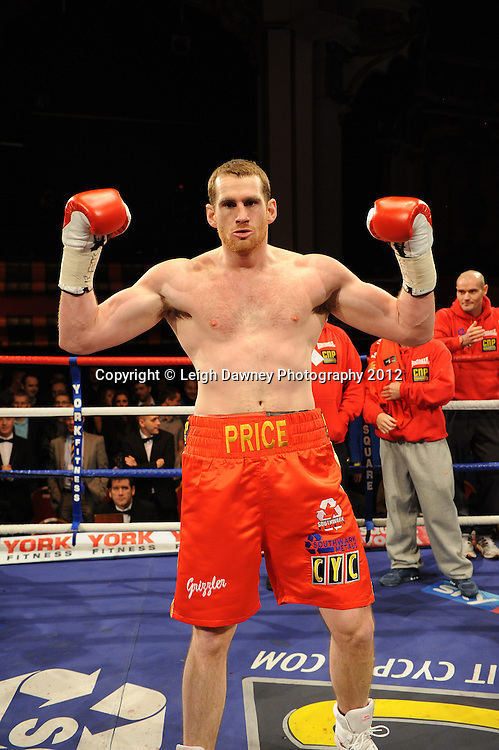 David Price triumphant after defeating John McDermott in 12x3 min contest to claim The British Heavyweight Title Eliminator at Olympia, Liverpool on the 21st January 2012. Referee Howard John Foster. Frank Maloney Promotions on Skysports HD1. © Leigh Dawney Photography 2012.