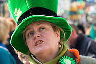 A woman in a giant Irish hat during the St Patrick's Day Parade in Westminster, London.<br /> Picture by Paul Davey/Focus Images Ltd +447966 016296<br /> 13/03/2016