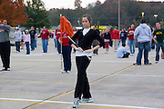 USA, University of Arkansas at Fayetteville marching band practicing for a football game master of ceremony with her staff