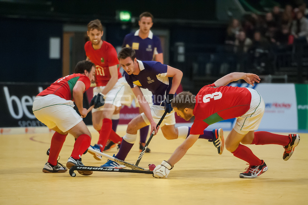 Sevenoaks' Nick Barker is tackled by Ali Bray and Ben Allberry of Canterbury. Sevenoaks v Canterbury - Hockey 5s, SSE Arena, Wembley, London, UK on 25 January 2015. Photo: Simon Parker