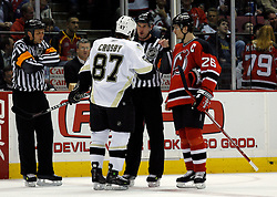 Mar 14, 2007; East Rutherford, NJ, USA;  New Jersey Devils center Patrik Elias (26) and Pittsburgh Penguins center Sidney Crosby (87) speak with the referee during the first period at Continental Airlines Arena in East Rutherford, NJ. Mandatory Credit: Ed Mulholland-US PRESSWIRE Copyright © 2007 Ed Mulholland
