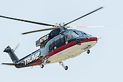GOP Presidential nominee Donald Trump arrives by private helicopter welcomed by Vice Presidential nominee Indiana Governor Mike Pence and his children for the Republican National Convention July 20, 2016 in Cleveland, Ohio. Trump flew into the lakeside airport by his private jet and then by helicopter for a grand arrival.
