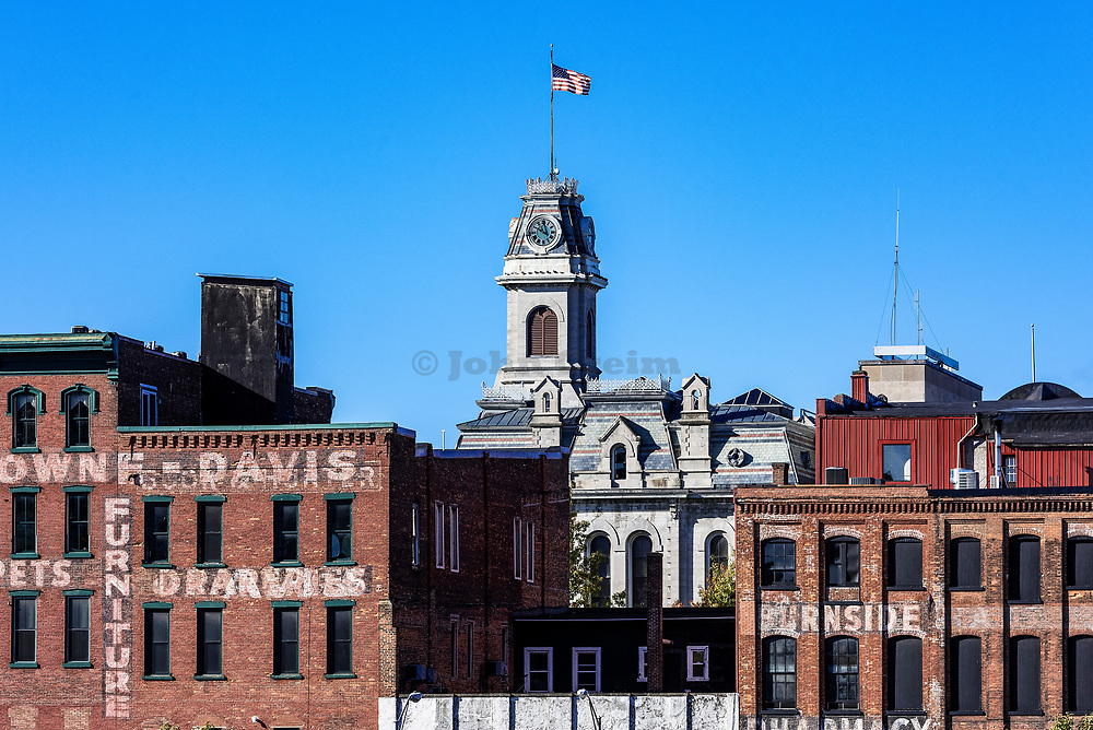 City Hall clock tower and surrounding buildings, Oswego, New York, USA.