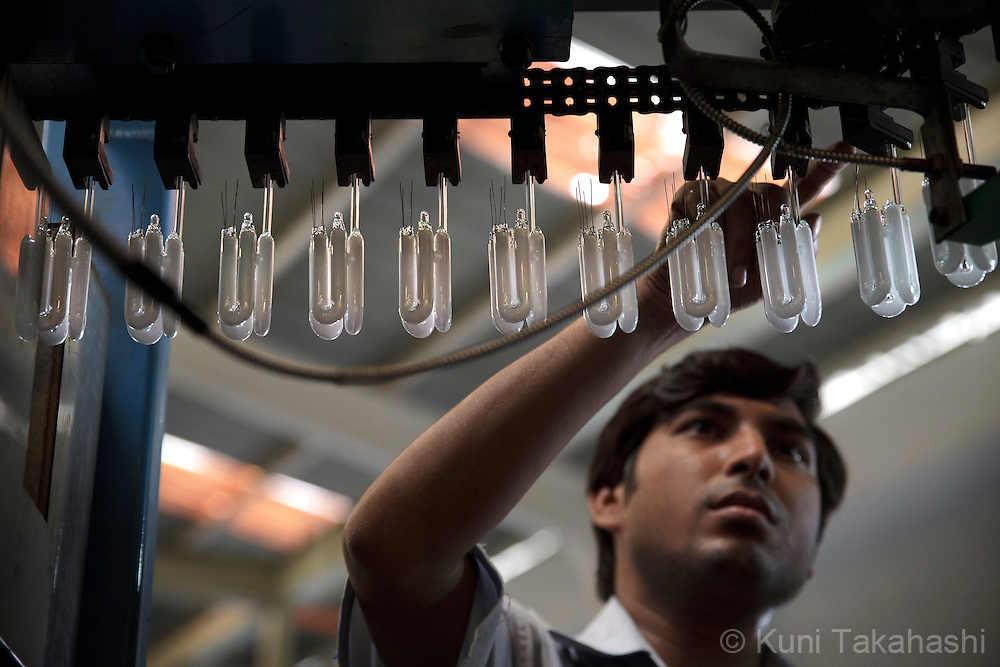 A worker checks burners (capsule light bulbs) at factory at Starlite Lighting Limited, a partner with Bajaj Electricals, in Nasik, Maharashtra, India on June 5, 2012.<br /> (Photo by Kuni Takahashi)