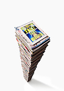 Very Large Pile Of Magazines With iPad2 On Top