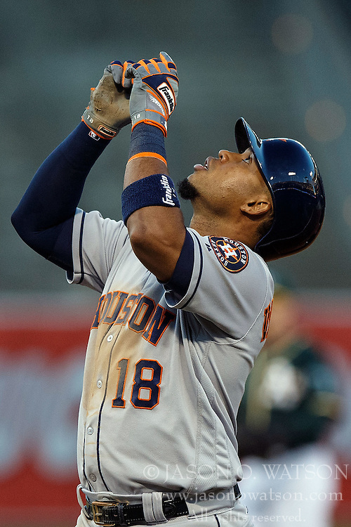 OAKLAND, CA - JULY 19:  Luis Valbuena #18 of the Houston Astros celebrates after hitting a RBI single against the Oakland Athletics during the third inning at the Oakland Coliseum on July 19, 2016 in Oakland, California. The Oakland Athletics defeated the Houston Astros 4-3 in 10 innings.  (Photo by Jason O. Watson/Getty Images) *** Local Caption *** Luis Valbuena