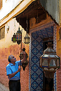 Antique seller sets up his shop for the day, Meknes