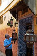Antique seller sets up his shop for the day, Meknes